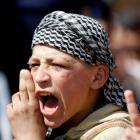 A Syrian refugee boy shouts slogans during a protest against Syrian President Bashar al-Assad at...