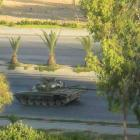 A tank with crew loyal to Syria's President Bashar al-Assad is seen at Al Mezza in Damascus....