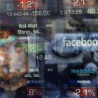 A television reporter talks about the Facebook IPO at the Nasdaq Marketsite in New York. Photo by...