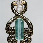 A Tony Williams creation. Serpent pendant in 18ct gold with aquamarine, diamonds and enamel.