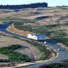 A truck carrying a church from Balclutha to Clydevale - the long way -  crawls up the hill from...