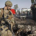 A US soldier views the scene of a suicide attack in Jalalabad, Afghanistan on Wednesday. The...