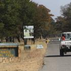 A vehicle carries visitors arriving at Zimbabwe's Hwange National Park. REUTERS/Philimon Bulawayo