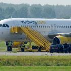 A Vueling plane sits by a field near Amsterdam Airport after a hijack scare which led the...