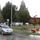 A warning to motorists on an electronic message board at the One Mile Roundabout, Queenstown,...