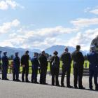A West Coast-Tasman police contingent marks Police Remembrance Day at Kowhitirangi yesterday by...