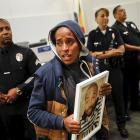 A woman protests the death of Ezell Ford during a meeting of the Los Angeles Police Commission on...