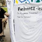 A woman writes slogans on a symbolic minaret erected to protest against the results of a vote in...