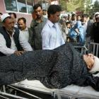A wounded policewoman receives treatment at a hospital after an explosion on a police vehicle in...