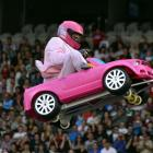 Aaron 'Crum' Sauvage flies high in a toy car last night.