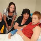 Aaron Macahan (right) recovers in Dunedin Hospital last month with his father, Mark, twin sister...