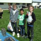 Aaron Stevenson (11) (left), Jade Thompson (7), and Scott Stevenson (9), all of Milton, had a...