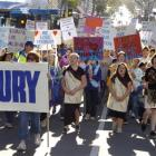 About 1000 people protest against the closure of Forbury School during a march on George St,...