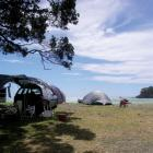 Absolute beachfront camping at Maraehako Bay, from the book 'Let's Go Camping'. Photo by Sarah...