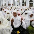 Acehnese women attend a mass prayer for the 2004 tsunami victims at Baiturrahman Grand Mosque in...