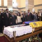 Acting Venezuelan President Nicolas Maduro swears an oath before the coffin of late Venezuelan...