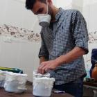 Activists and medics manufacture homemade chemical masks in the Damascus suburb of Zamalka....