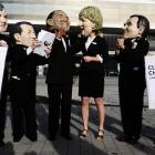 Activists of anti-poverty group Oxfam wearing masks of world leaders fron left to right: British...