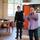 Actors (from left) Jon Pheloung, Jake Metzger and Phil Vaughan rehearse for the Fortune Theatre's...