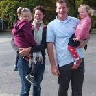 Adventurer Jamie Fitzgerald with his family.  His wife, Kate, holds Charlotte and  Jamie holds...