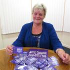 Age Concern Otago social worker Marie Bennett displays  new purple badges to be distributed to...