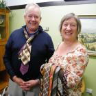 aimate Mayor Craig Rowley tries some ties on for size from Irene Sparks, who is aiming to set a...