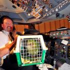 Air New Zealand captain Eric Fontein shows  Sirocco the cockpit. Photo by Craig Baxter.