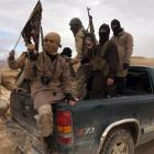 Al Qaeda-linked Nusra Front fighters during the release on December 1 of Lebanese soldiers and...