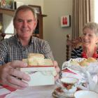 Alan and Gaye McElroy with a scone baked by Mr McElroy's mother in 1938 and still intact. Photo...