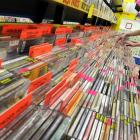 Alex Scahill organises compact discs at JB Hi-Fi's new store in the Meridian mall yesterday....