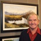 Alexandra artist Denis Kent with his winning entry in the Blossom Festival art exhibition. Photo...