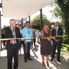 Alexandra Community House trust chairwoman Bernie Lepper and Central Otago Mayor Tony Lepper cut...