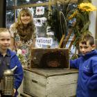 Alexandra Primary School pupils (left) Madie Hill (7) holding a bee smoker and (right) Quin...