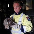 Alexandra Volunteer Fire Brigade Station Officer Shane Ryan with the toaster that caused Friday's...
