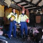Alexandra volunteer firefighters Shane Ryan and Nathan Mawhinney survey the damage to the kitchen...