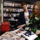 Aliana McDaniel looks over a fashion spread in Black magazine featuring her model, Tom Parsons ...