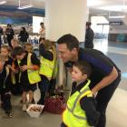 Ben Smith poses for a photograph with Angus McGregor (6), of Elmgrove School, at Dunedin Airport....
