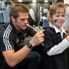 All Black captain Richie McCaw signs a jersey for Elizabeth Darling (6), of Dunedin, at Champions...