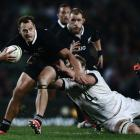 All Black fullback Israel Dagg makes a break against England. (Photo by Hannah Peters/Getty Images)