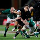 All Black halfback Aaron Smith is tackled by Ireland's Peter O'Mahony (R) during their test at...
