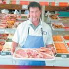 Alliance Group Butcher Shop manager Chris Duffy with a tray of pork chops, which are popular with...