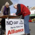 Alliance Party members, from left, Eunice Billot and Gail Marmont collect signatures in South...