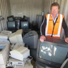 AllWaste manager Mark McKone stands  at the Queenstown Refuse Station  beside the latest...