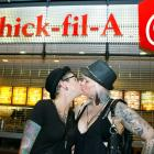 Ally Wells and Heather Michelle (R), participate during the nationwide 'kiss-in' at a Chick-Fil-A...