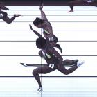 Allyson Felix and Jeneba Tarmoh (foreground) hit the finish line at the same time during the...