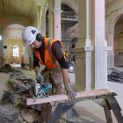 Amalgamated Builders leading hand Kent Newman works inside St Patrick's Basilica in South Dunedin...