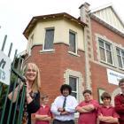 Amana Christian School principal Liz Bishop with pupils (from left) Harry Granger (12), Tim...