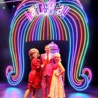 Amanda Richards (Tracy), Andrew Coshan (Link) and Hayley Carrick (Amber) perform in front of the...