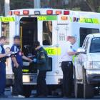 Ambulance staff treat the victim of a stabbing outside the Russell Street Nursery in Dunedin...