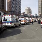 Ambulances line the street after explosions interrupted the running of the 117th Boston Marathon...